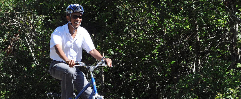 US President Barack Obama rides his bicy