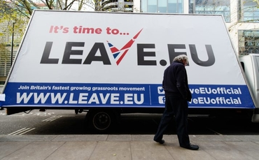 """A man walks past a campaign poster ahead of a press briefing by the """"Leave.EU"""" campaign group in central London on November 18, 2015. Britain will decide in a referendum to be held by 2017 if they should remain within the European Union. AFP PHOTO / LEON NEAL        (Photo credit should read LEON NEAL/AFP/Getty Images)"""